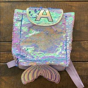 Sequin justice backpack initial A